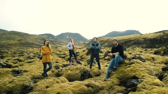 Thumbnail for Aerial View of Tourists in Lava Field in Iceland Copter Moving Away From Friends, Selfie on Drone
