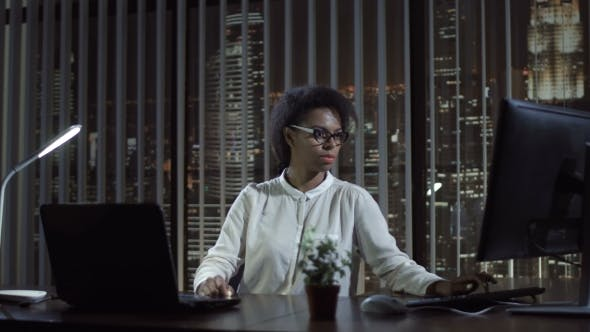 Thumbnail for Black Woman Working in Office