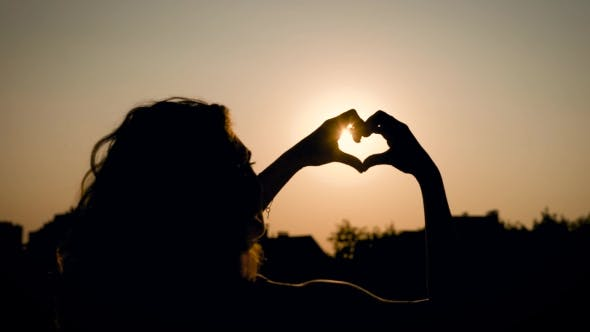 Thumbnail for Silhouette of a Woman Who Is in the Nature, the Lady Hands a Heart Shape