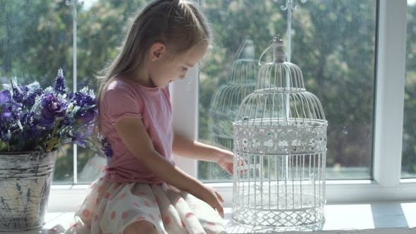 Thumbnail for Young Girl Sitting at Cage