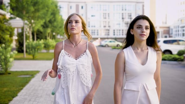 Thumbnail for Attractive Friends Chat About Life on a Summer Day, Girls Are Walking Along the Street and Talking
