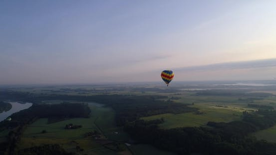 Thumbnail for Air Baloon Over Green Lands at Early Mornig