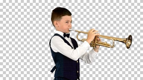 Young boy in a bow tie playing the trumpet, Alpha Channel