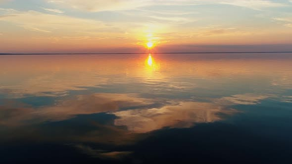 Thumbnail for Fly Over Calm Water To Sunset