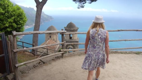 Young Blonde Woman Walking in Ravello at Italy