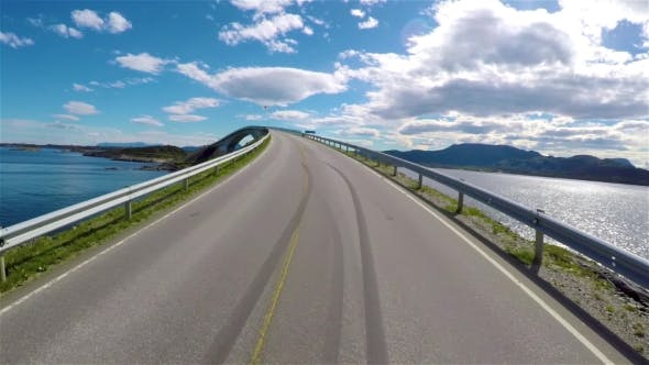 Cover Image for Driving a Car on a Road in Norway Atlantic Ocean Road or the Atlantic Road