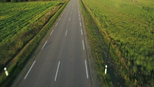 Thumbnail for Flying Above Road in Fields