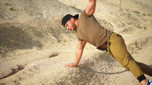 Thumbnail for Sporty Man Does Push-up From the Ground, He Strengthens the Muscles of His Hands