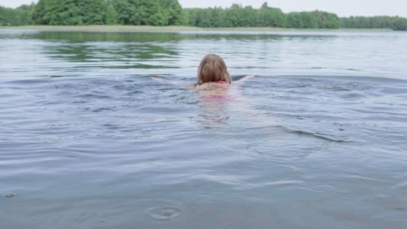 Thumbnail for Woman Swimming in the Lake