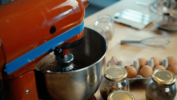 Thumbnail for View of Working Red Mixer Standing at the Table in the Kitchen Whisk Preparing the Dough for