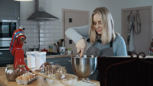 Thumbnail for Young Beautiful Woman Mixing the Ingredients in a Bowl, Preparing Dough for Baking Blonde Female in