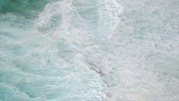 Thumbnail for Aerial view of waves crashing on the shore at Punta Guadalupe.
