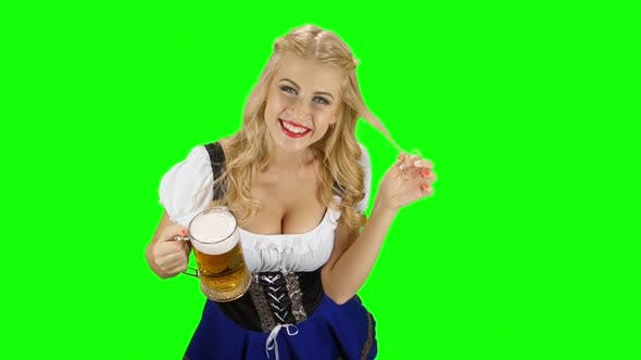 Thumbnail for Girl in Bavarian Costume Drinking Beer and Licks Her Lip. Green Screen