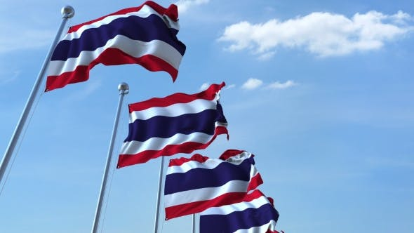 Cover Image for Row of Waving Flags of Thailand Agaist Blue Sky
