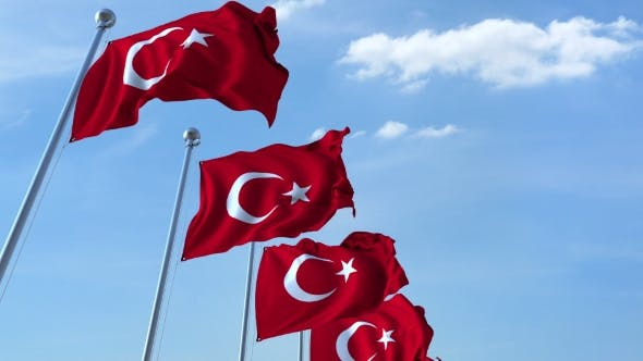 Cover Image for Row of Waving Flags of Turkey Agaist Blue Sky