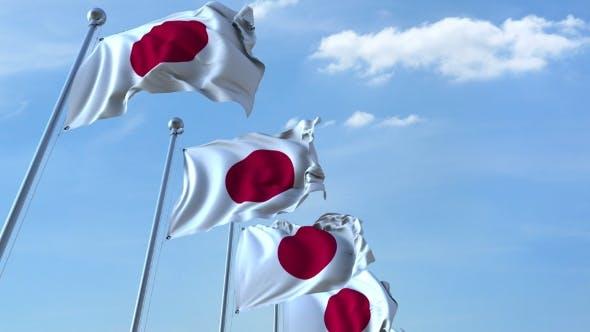 Thumbnail for Row of Waving Flags of Japan Agaist Blue Sky