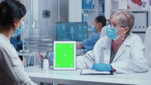 Doctor Showing Green Screen Tablet