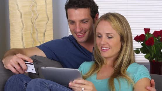 Thumbnail for Couple browsing the web on tablet