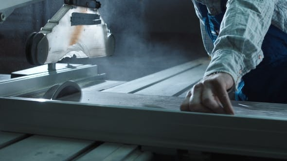 Cover Image for Man Cutting Detail in Workshop