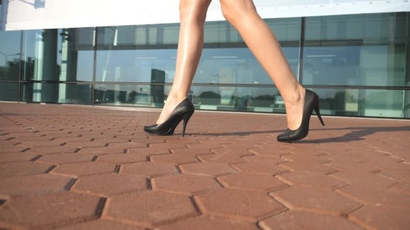 Thumbnail for Female Legs in High Heels Shoes Walking in the Urban Street with Contemporary Business Office