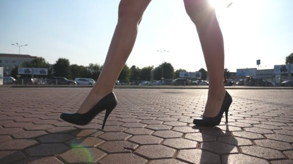 Female Legs in High Heels Shoes Walking in the Urban Street, Feet of Young Business Woman in High