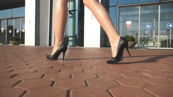 Cover Image for Feet of Young Woman in High-heeled Footwear Going in the City, Female Legs in High Heels Shoes