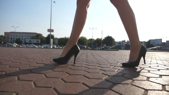 Thumbnail for Female Legs in High Heels Shoes Walking in the Urban Street