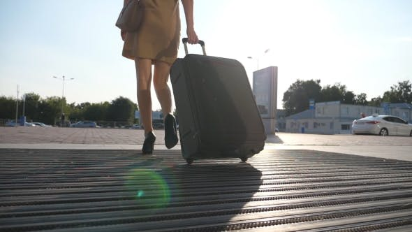 Thumbnail for Business Lady Going To Taxi Parking From the Airport with Her Luggage. Girl in Heels Stepping