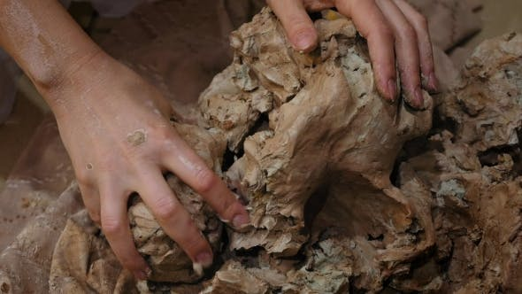Thumbnail for Sculptor Is Pugging Clay for Creating Pottery
