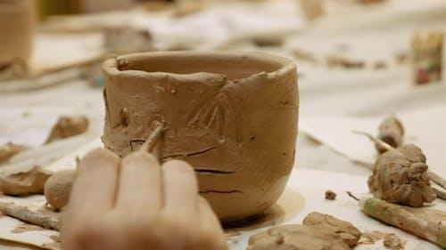 Ceramist Is Modeling Clay Pot or Vase Bowl