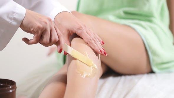 Thumbnail for Epilation Sugar Processes Woman Passes in a Beauty Salon.