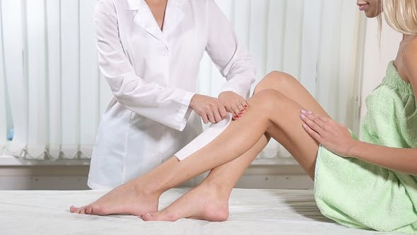 Thumbnail for Beautician Removing Leg Hair with Wax.