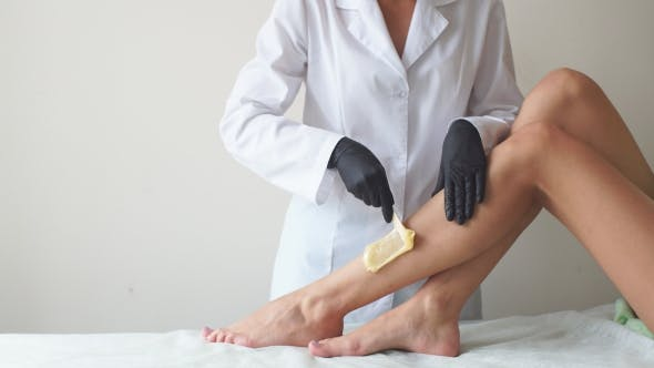 Thumbnail for Woman in a Beauty Salon Doing Depilation