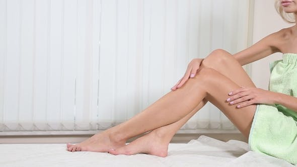 Thumbnail for The Young Woman with Perfect Body Is Sitting with Smooth Silky Legs After Depilation. Concept of