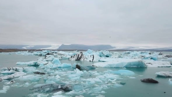 Thumbnail for Aerial Over Icebergs Floating in Jokulsarlon Lagoon By the Southern Coast of Iceland