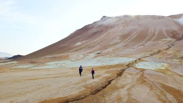 Thumbnail for Gray Geysers in Iceland Trekking Tourists