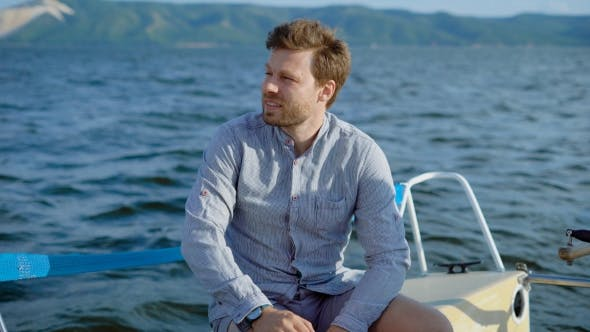 Thumbnail for Pensive Man on Yacht Sitting and Enjoying Views of Sea