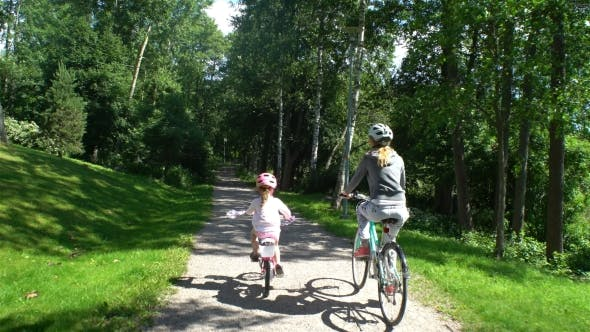 Thumbnail for Mom and Daughter Ride Bicycles in the Park