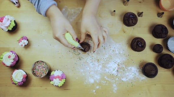 Thumbnail for Top View of Female Hands Decorating the Chocolate Cupcakes