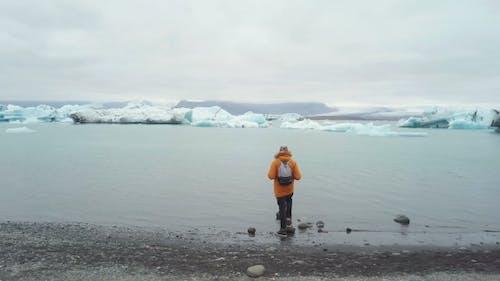 Tourists at Glacier Lagoon, Vatnajokull National Park, Iceland.