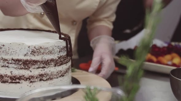 Thumbnail for Female Pastry Chef Decorates Sponge Cake with Melted Chokolate