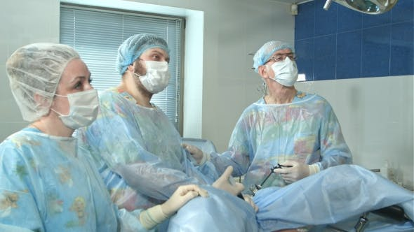 Thumbnail for Team of Doctors Working Together During a Surgery in an Operating Room at a Hospital