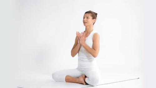 Senior Woman in White Space Practice Yoga