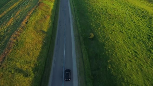 Cover Image for Aerial View of Sport Car Driving in Fields