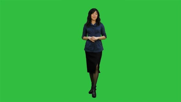 Thumbnail for Young Asian Women Standing and Talking to a Camera on a Green Screen