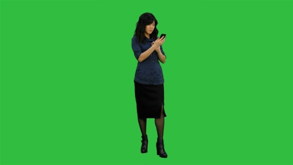 Thumbnail for Asian Businesswoman Using Mobile Phone on a Green Screen, Chroma Key