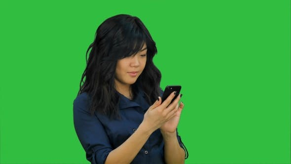 Thumbnail for Businesswoman Using of Mobile Phone on a Green Screen, Chroma Key