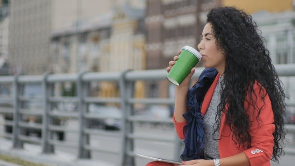 Thumbnail for Curly Pretty Lady Drinks Coffee Outside
