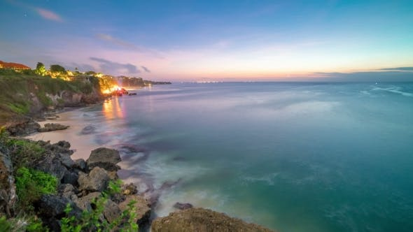Thumbnail for of the Coming Night on the Rocky Beach of Bali Island in Indonesia.