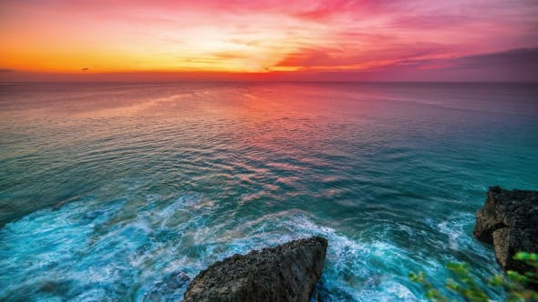 Cover Image for The Incredible Sunset  Overlooking the Ocean and Rocks on the Island of Bali in Indonesia.